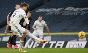 Patrick Bamford of Leeds United scores their team's first goal from the penalty spot.