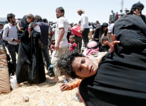 Refugees are waiting on the Syrian side of the border crossing near Akçakale