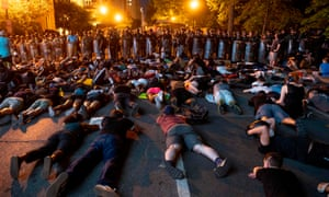 Demonstrators lie on the ground facing a police line in front of the White House during protests over the death of George Floyd in Washington DC on Wednesday.