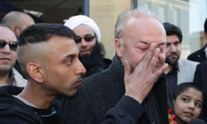 A supporter of George Galloway wipes the politician's face after an egg was thrown at him before a victory bus tour in Bradford in 2012.