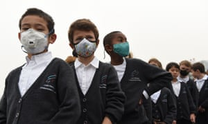 Children wear masks to protect from pollution in China