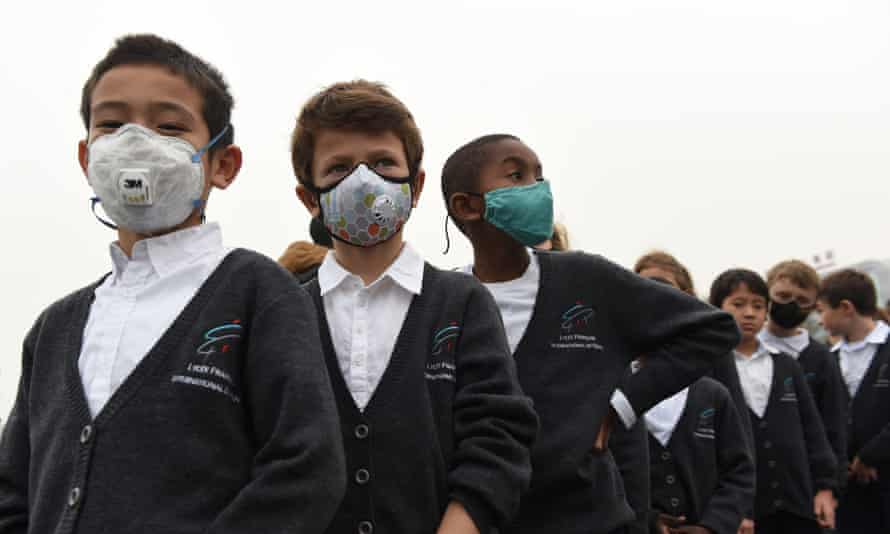 Children wear masks to protect against pollution at a school in Beijing.