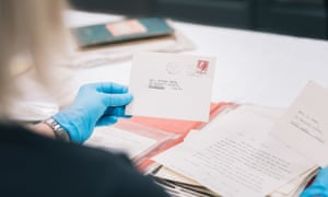 A member of the State Library preservation team with a letter addressed to Helena Cass.