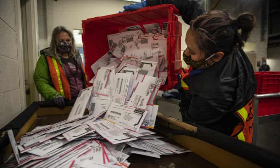 Workers count ballots in Portland. Those findings challenge the conventional wisdom that has emerged after Joe Biden's victory in November that the Democrats benefited from mail-in votes.