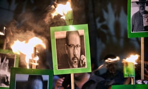 Pictures of Javier Valdez, a journalist murdered in May, at a protest in Mexico City calling for his killers to face justice.