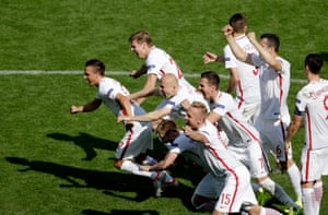 Poland players celebrate after Grzegorz Krychowiak's decisive penalty in the second round shoot-out against Switzerland at Stade Geoffroy Guichard in Saint-Etienne.