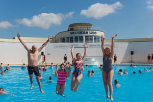 Travel Photograph taken during the opening at Saltdean Lido in Brighton. In photograph, Bassin family: Janvier, Edie, Renee, Emily interviewed by Jenny. Photograph: Alecsandra Raluca Dragoi for the Guardian