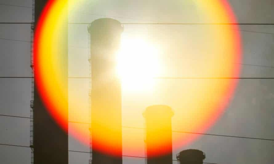 Sun is seen rising behind funnels of brown coal Hazelwood power station in Latrobe Valley