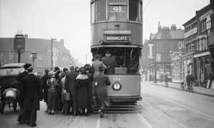 City workers are running to catch the tram at Palmer's Green11th March 1936 London