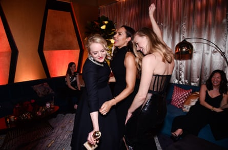 (L-R) Handmaid's Tale co-stars Elisabeth Moss, Amanda Brugel and Yvonne Strahovski at a party in Los Angeles.