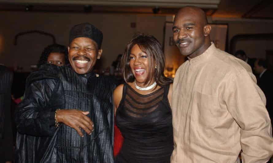 Lloyd Price, left, and Mary Wilson, of the Supremes, with the boxer Evander Holyfield.