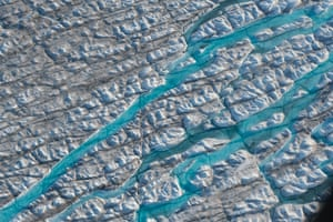 Rivers of meltwater carve into the Greenland ice sheet near Sermeq Avangnardleq glacier in August 2019 near Ilulissat, Greenland