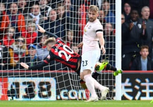 David Brooks goes down under a challenge from Manchester United's Luke Shaw.