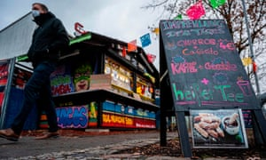 A sign outside a kiosk in Berlin offers Impfehlung des Tages instead of the usual Empfehlung des Tages (special of the day), a play on impfen, to vaccinate. Photograph: John MacDougall/AFP/Getty Images