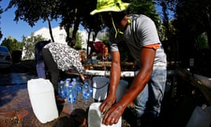 Residents of Cape Town collect drinking water from a mountain spring collection point