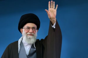 A handout picture released by the official website of the Centre for Preserving and Publishing the Works of Iran's supreme leader Ayatollah Ali Khamenei, shows him saluting the people during a recent meeting in Tehran.