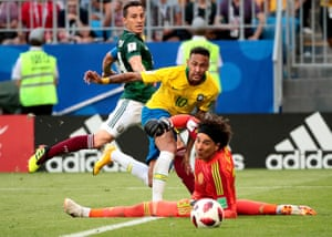 Neymar of Brazil passes the ball to Roberto Firmino for Brazil's second goal