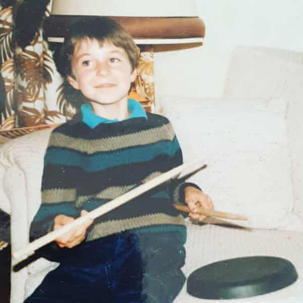 Mike Noga as a kid, playing with drumsticks