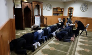 Muslim men pray at a mosque in Jersey City, New Jersey.