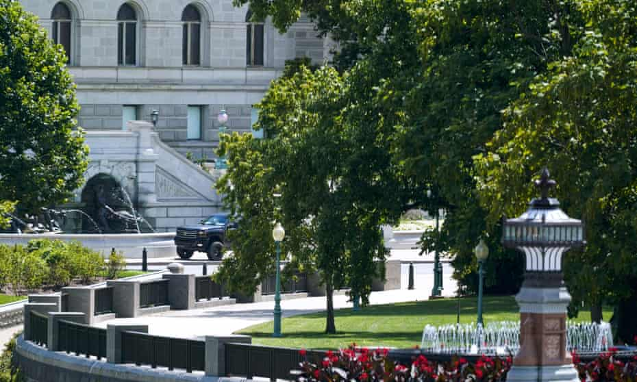 A pickup truck is parked on the sidewalk in front of the Library of Congress' Thomas Jefferson Building on Thursday. The standoff was resolved peacefully after roughly five hours.