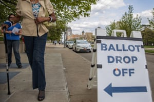 Ohio voters walk to drop off their ballots at the Board of Elections in Dayton, Ohio on April 28, 2020. On March 17, 2020 Governor Mike DeWine and Ohio Department of Health Director Amy Acton delayed Ohio primaries over coronavirus concerns. The primaries were changed exclusively to a vote-by-mail system to reduce chances of virus spread.