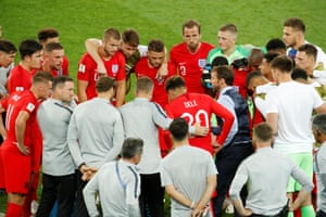 England's players huddle before extra-time.