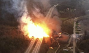 A fireball erupts across Interstate 77 from a pipeline explosion. The gas company failed to conduct inspections or tests that might have revealed weaknesses in the massive pipeline.