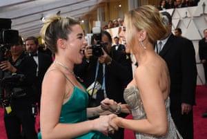 Florence Pugh and Scarlett Johansson share a joke on the red carpet