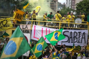 <strong>Porto Alegre </strong>Demonstrators protest against Brazilian President Dilma Rousseff and the ruling Workers Party. A massive corruption scandal at Brazil's state-owned oil company Petrobras has rocked the nation which is now in the midst of a hard-hitting recession ahead of the Rio 2016 Olympic Games. Rousseff's approval rating has dropped below ten percent.