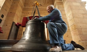 Peter Scott, a senior bell hanger for the Whitechapel Bell Foundry, manoeuvres a bell into the church of St Magnus the Martyr on March 2, 2009 in London.