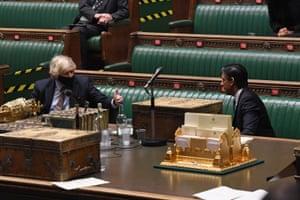 Boris Johnson congratulating Rishi Sunak at the end of Sunak's budget speech in the Commons.