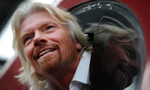 Sir Richard Branson leans out of the window of the drivers cab on board a Virgin Pendolino train at Lime Street Station in Liverpool