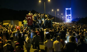 Crowds gather near the Fatih Sultan Mehmet Bridge during clashes with military forces in Istanbul