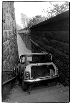 A burnt Mini on the steps of the former Scotswood station, 1990.