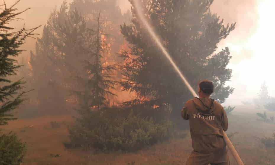 A firefighter trying to extinguish wildfire in the republic of Yakutia, Russia, in August 2021.