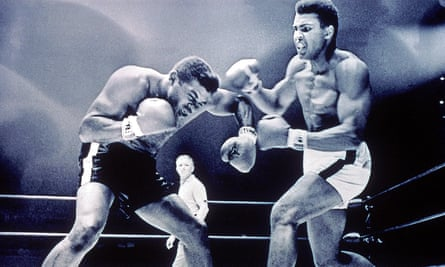 Ali and Floyd Patterson spar during their first fight, in 1965.