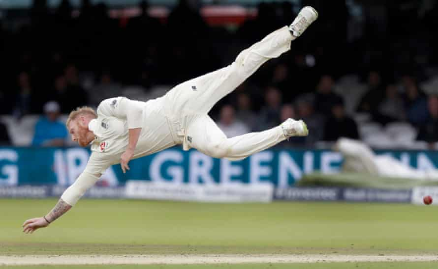 Ben Stokes dives to stop a ball off his own bowling during the second day of the England v West Indies 3rd test match at Lord's Cricket Ground.