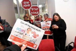 Anti-Adani protesters are seen inside Bill Shorten's Melbourne office in July 2017.