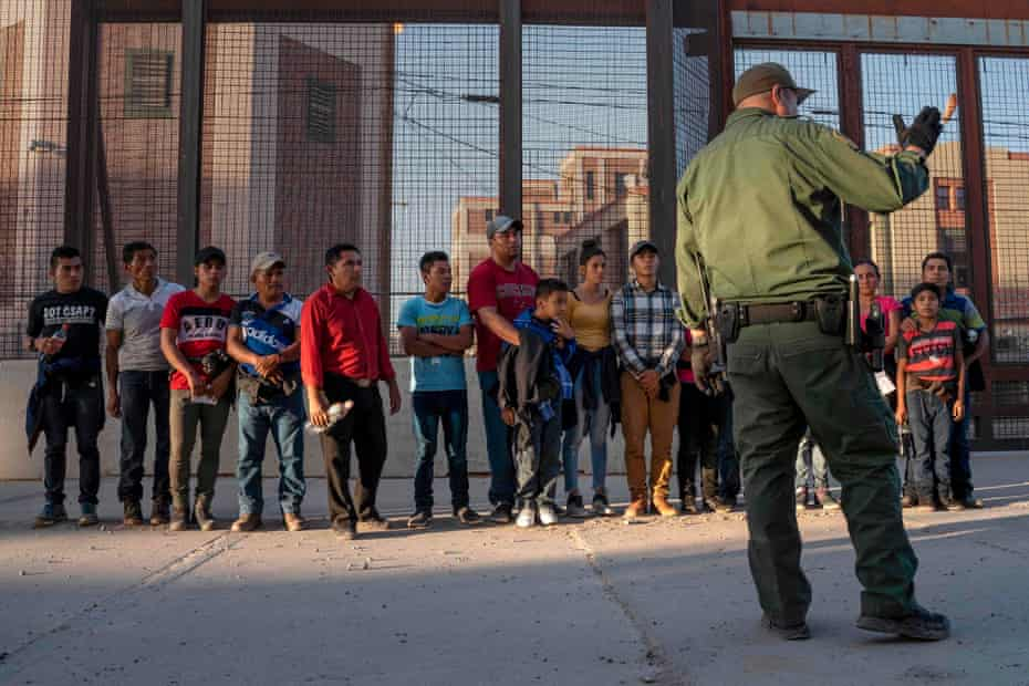 South American migrants ready to enter a processing center, in El Paso, Texas.