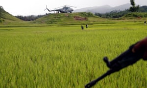A Myanmar army helicopter is seen in September 2017 after transporting journalists to an area where the bodies of Hindu villagers were found near Maungdaw in the north of Myanmar's Rakhine state, September 27, 2017.