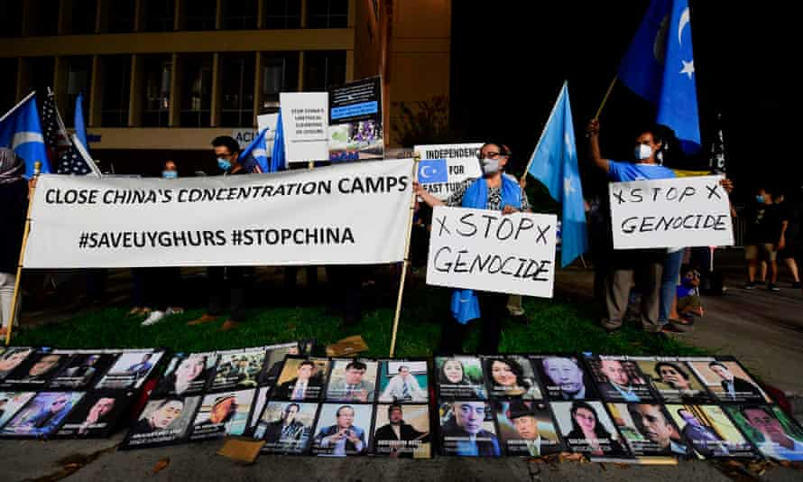 Protesters in Los Angeles display photographs of prominent Uighur intellectuals detained by China during a global day of action on 1 October.
