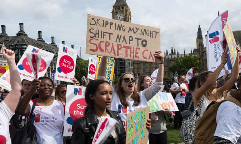 Nurses at a Royal College of Nursing rally to protest against the government's 1% pay cap in 2017 in Westminster, London.
