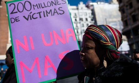 """A woman with a placard that reads """"200 million victims, no one more"""" protesting against FGM in Madrid in 2018"""