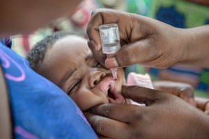 A baby being vaccinated in Benin