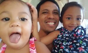 35-year-old Herbert Carino and his children.