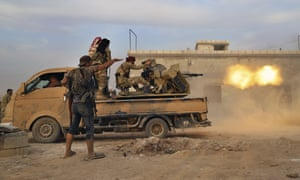 Turkey-backed Syrian opposition fighters fire a heavy machine gun towards Kurdish fighters in Syria