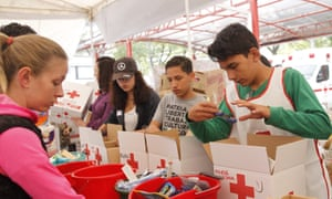 Young volunteers sort medicines and supplies at a collection centre in Mexico City on Friday.