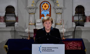 Angela Merkel speaks at the Synagogue Rykestrasse in Berlin last year to commemorate the 80th anniversary of Kristallnacht.