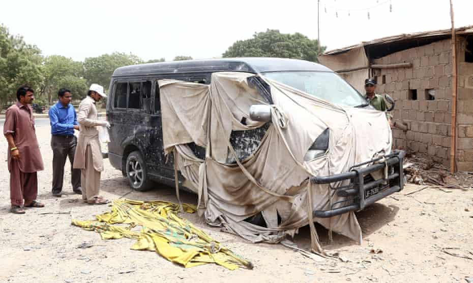 The Chinese worker and his driver were injured by a roadside bomb that hit their minibus in Karachi.