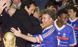 Michel Platini is pictured celebrating with France captain Didier Deschamps after the hosts beat Brazil in the 1998 World Cup final in Paris.